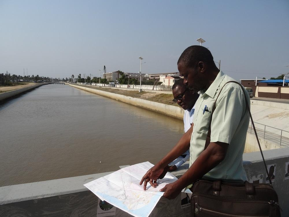 (From left) Jose Manuel Moisés, city councilor for institutional affairs and Beira city engineer, Augusto Manhoca, overlooking the canal which reduced the impact of the rains which hit Beira with Cyclone Idai in March, 2019